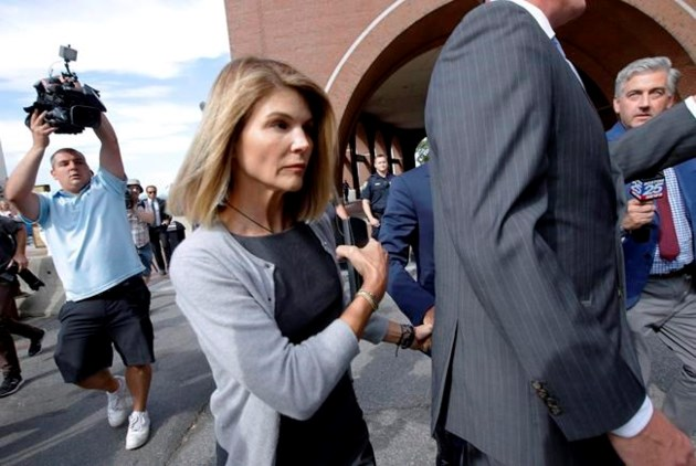 Actress Lori Loughlin reports to jail in school scam