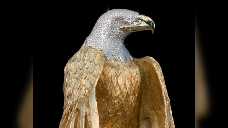 Diamond-encrusted golden eagle statue quiet missing; B.C. accurate battle over insurance protection continues