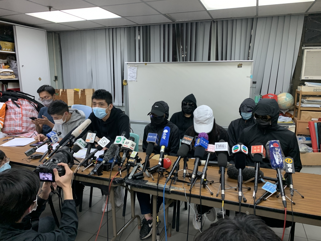 Households of 12 Hongkongers decry sentencing delay