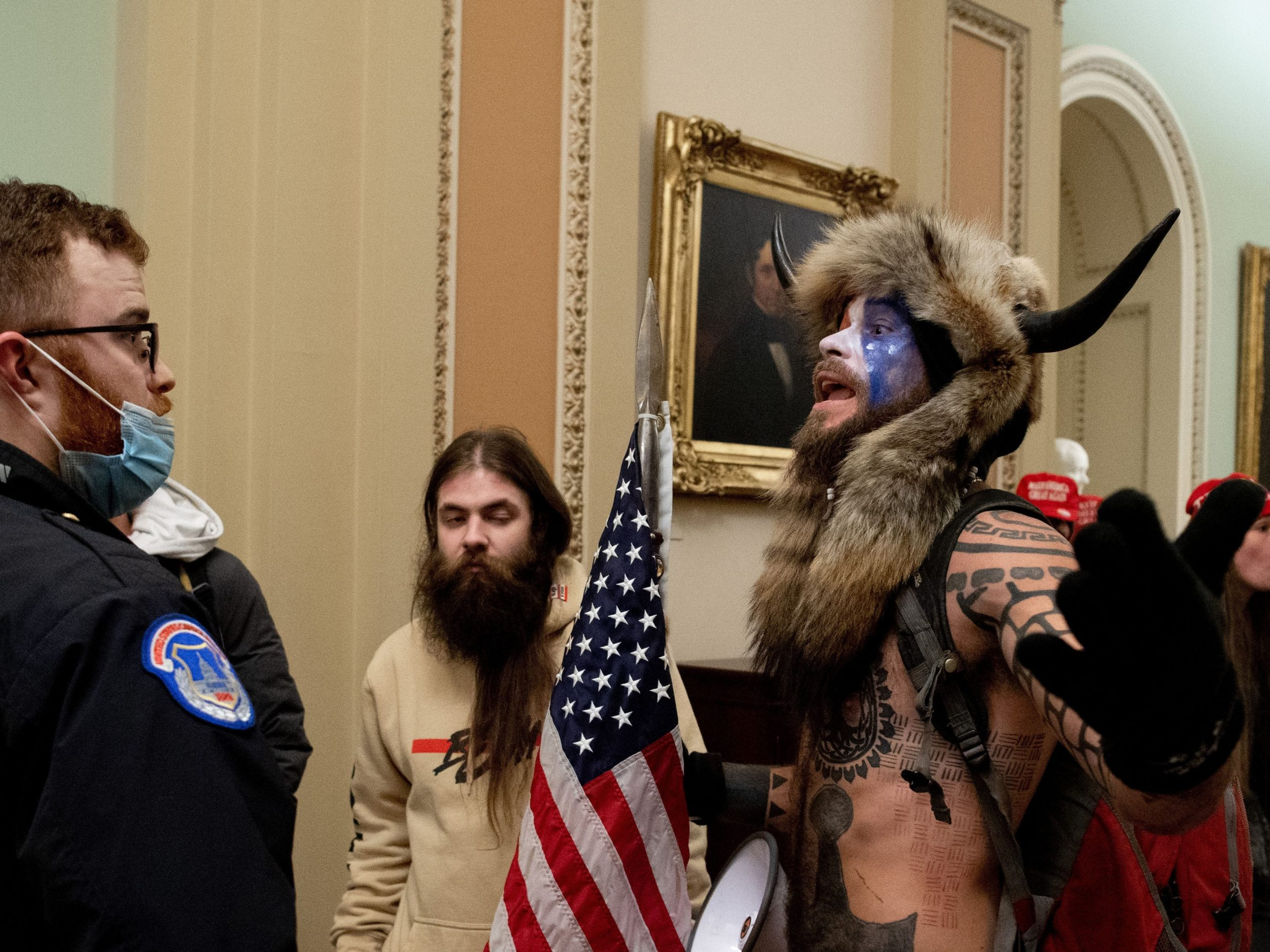 Lawyer for the 'Q Shaman' who stormed the Capitol in a fur headdress with horns says his consumer feels 'duped' after Trump did not pardon him
